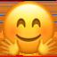 blij gezicht met handen uitgestoken voor een knuffel Emoji (Apple)