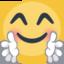 blij gezicht met handen uitgestoken voor een knuffel Emoji (Facebook)